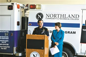 photo by Serianna Henkel Senator Amy Klobuchar (right) stands with local veteran and current Grand Forks policeman and paramedic at Northland Community and Technical College as the pair discuss the Veterans to Paramedics Transition Act this past Tuesday.