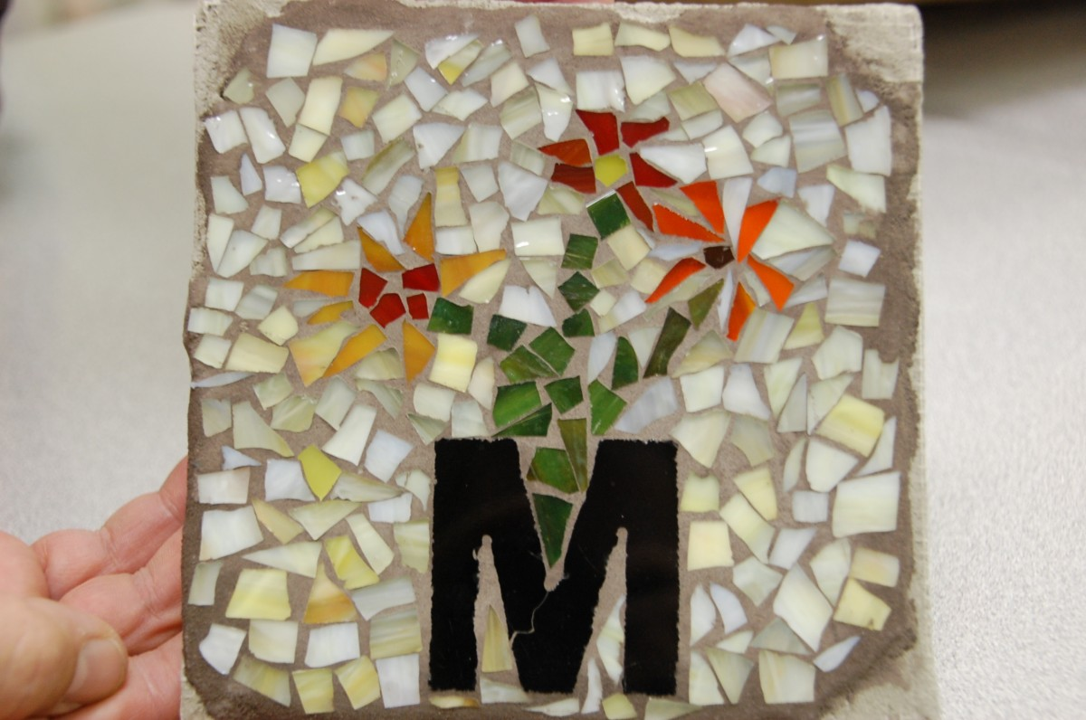 This six by six inch stained glass family square tile is one of currently 120 that will frame the entire main mosaic of the Badger Heritage Wall. The committee sold out the blocks, but is open to adding more tiles if interest remains.