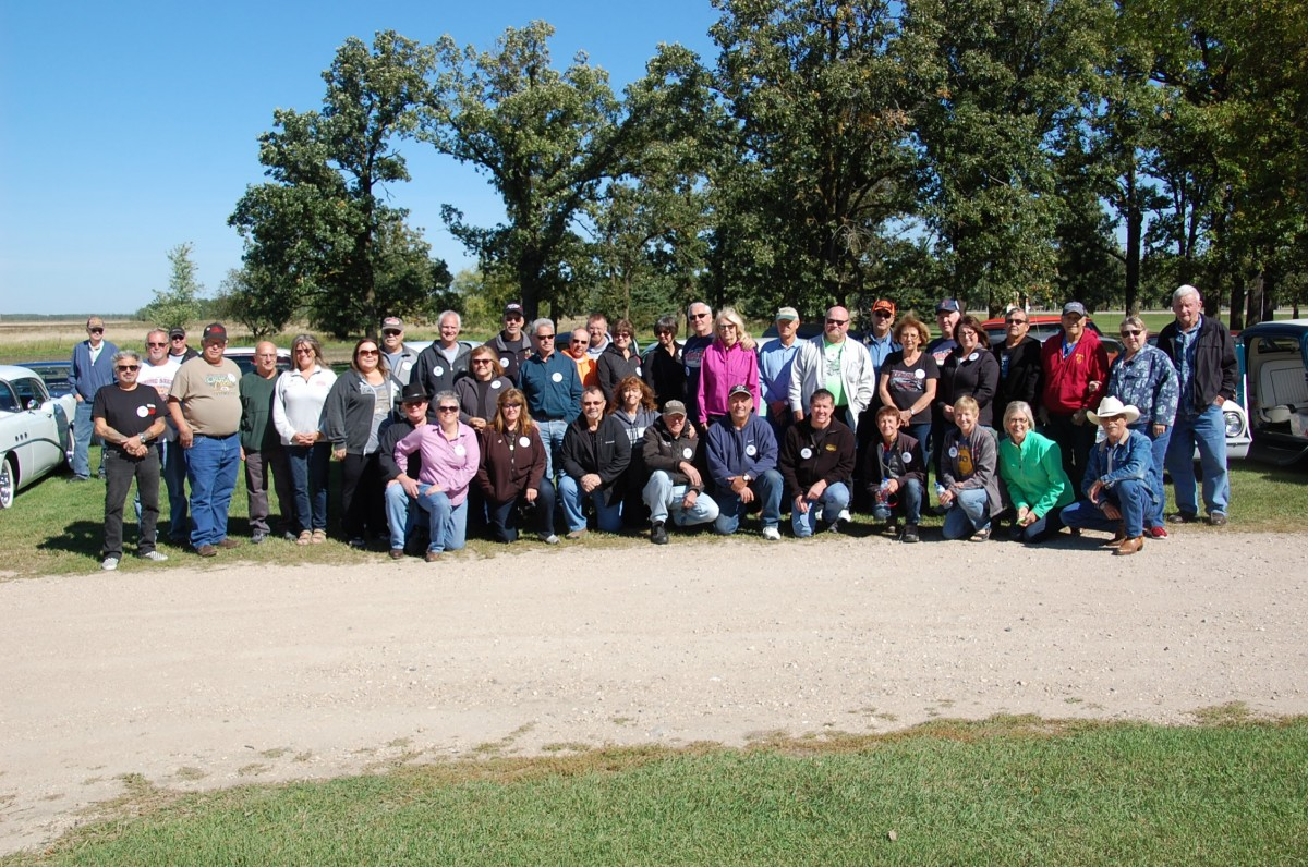 Individuals part of the Fourteenth Annual Leadfoot Lanny NSRA Car Cruise pose for a group photo at the Troy Gjovik residence during a pit stop in Greenbush on Wednesday, September 14.