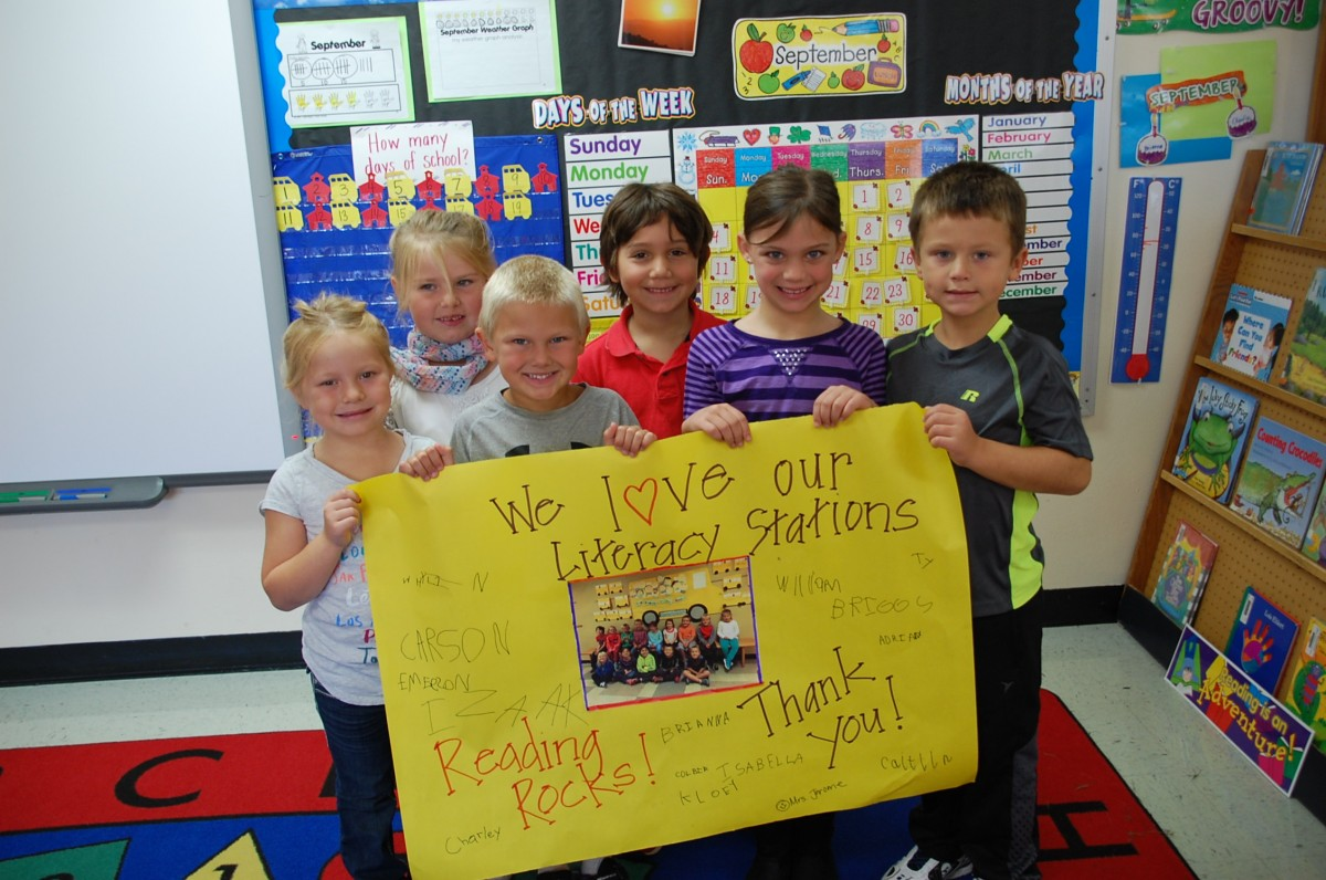 Some of Sheri Jerome's GMR (Greenbush site) kindergartners hold up the poster they and their teacher signed thanking the Greenbush Women of Today for providing the funds to help purchase additional features for their literacy stations. These stations allow students to develop their reading and writing skills, along with other ones in between. Here are some of her students (L-R): Charley, Colbie, Briggs, William, Brianna, and Whylin.