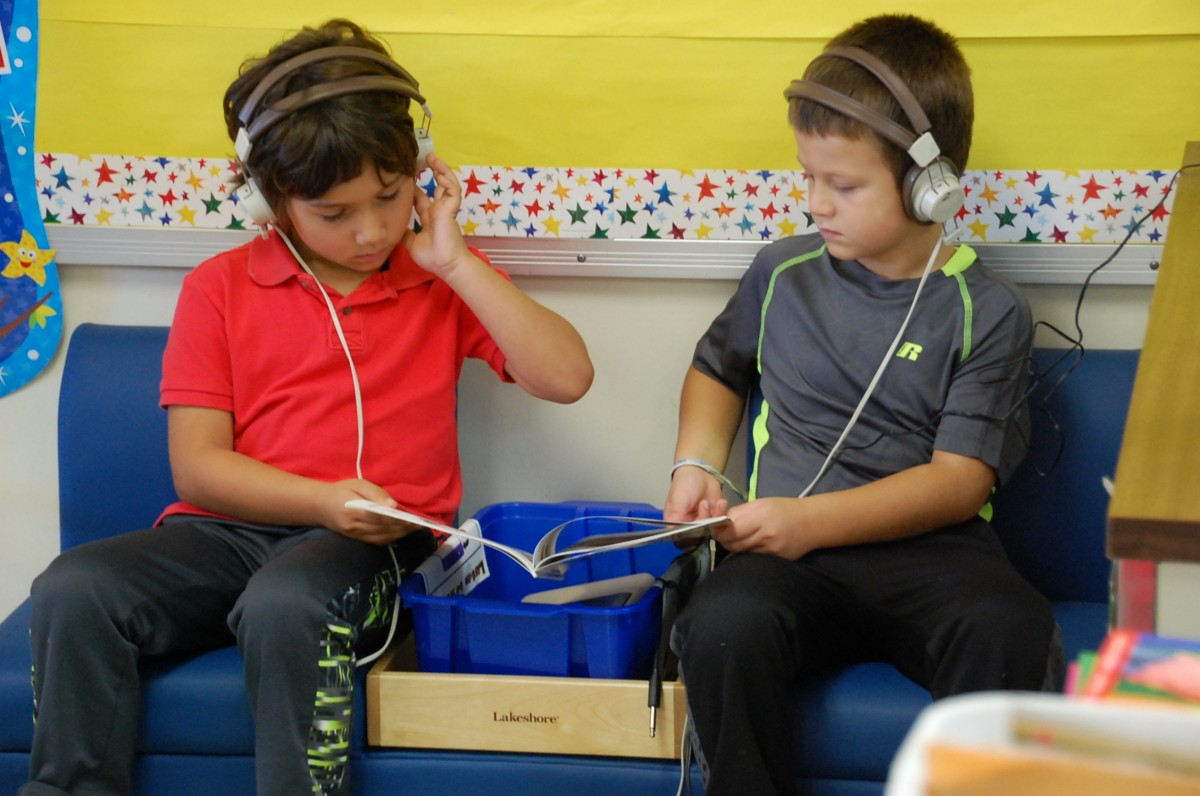 GMR kindergartners William and Whylin are all focus as they listen to a book on CD, flipping the pages at the sound of beep. The Greenbush WOT provided the funds to purchase the blue bench and the portable CD player.