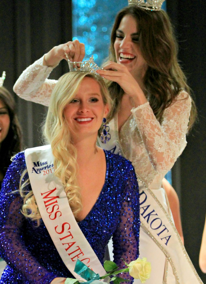 """Madison Truscinski reacts right after being crowned the 2017 Miss State Capitol, a Miss America Scholarship Pageant held in Bismarck, N.D. Truscinski enjoys competing in these pageants for several reasons-- to perform service work, meet and bond with fellow contestants, and to share her platform. Her platform, """"Operation Embrace the Mirror,"""" focuses on battling bullying. (photo by Val Truscinski)"""