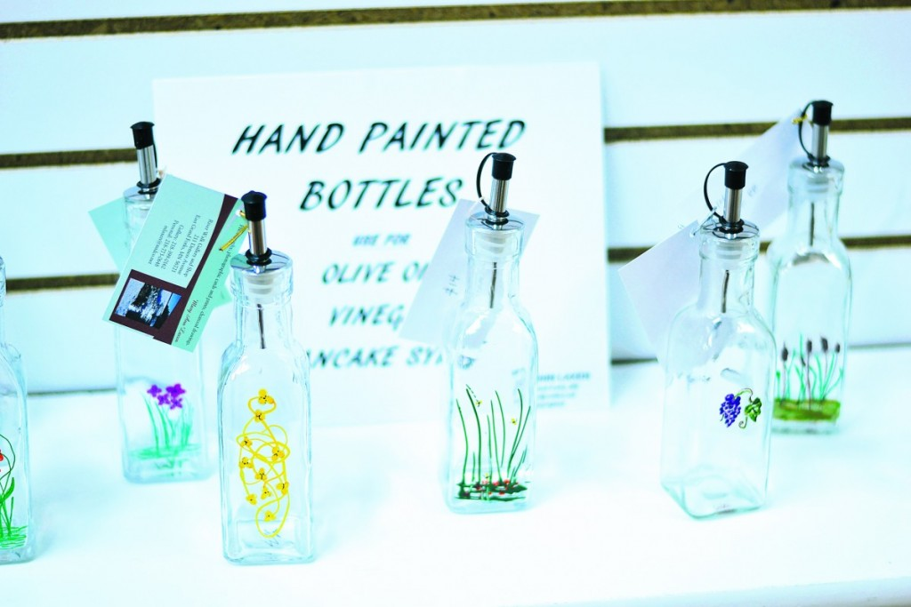 Hand painted bottles by Mary Ann Laxen. All proceeds from sales are sent to Haiti. (photo by Serianna Henkel)