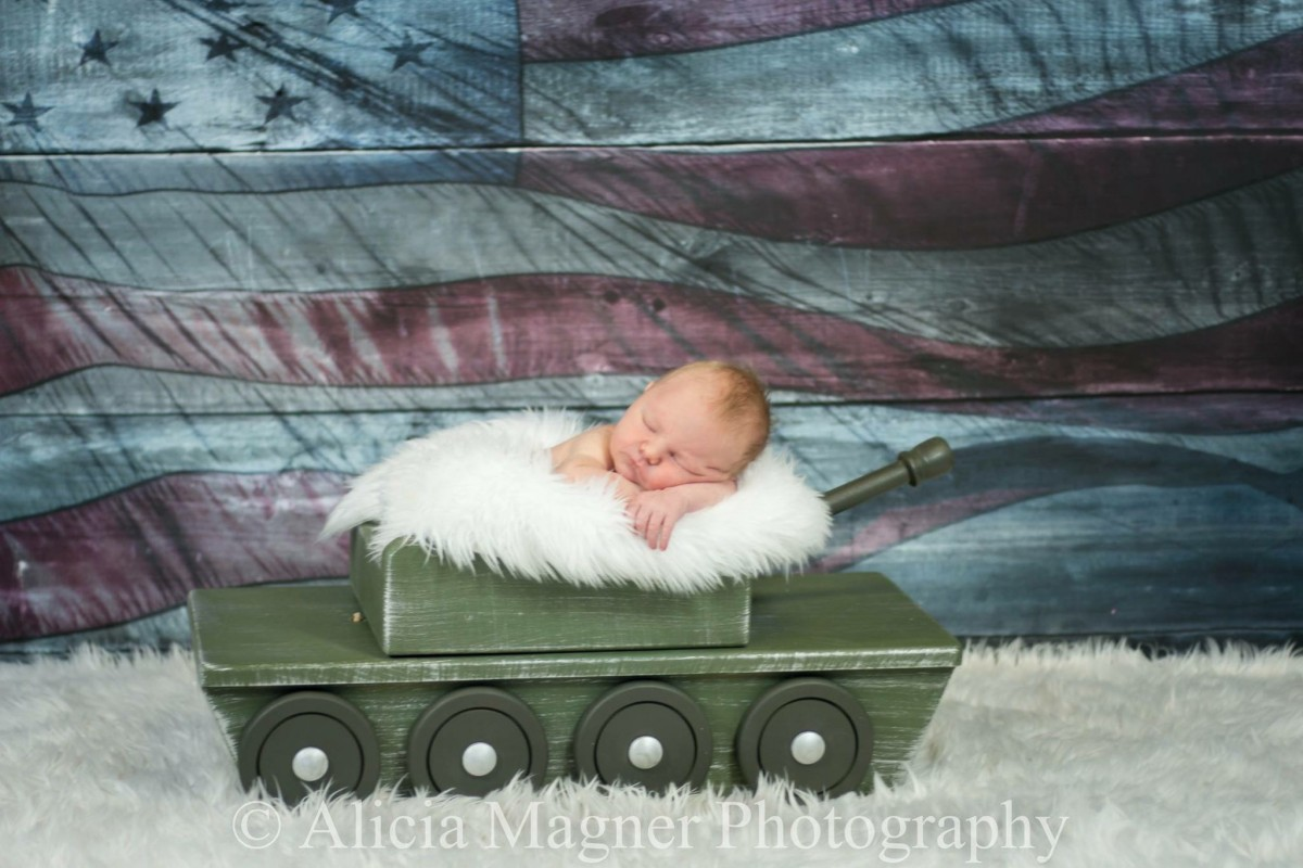 Alicia Magner's favorite type of photography is of newborns. She enjoys working to get them into certain positions, incorporating little outfits and props, such as Cinderella carriages with girls and military tanks with boys, and capturing their detail— their tiny squishy bodies, faces, and lips. (submitted photo)