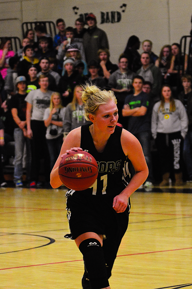 submitted photo Carly Mekash dribbles the ball along the perimeter as fans wait in anticipation for her to hit 1,000 points in the first half of the home versus KCC.