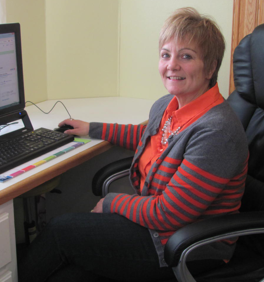 """Patti Robinson is """"right at home"""" in her office where she is in charge of the cabinet hardware department of Robinson's Hardware Supply."""