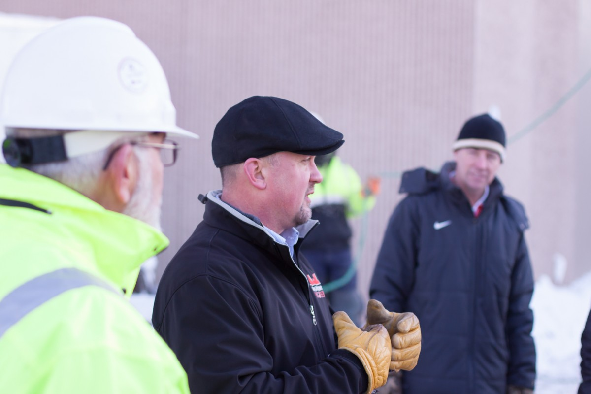 Tom McDonald of Construction Engineers explains history of a toping off ceremony