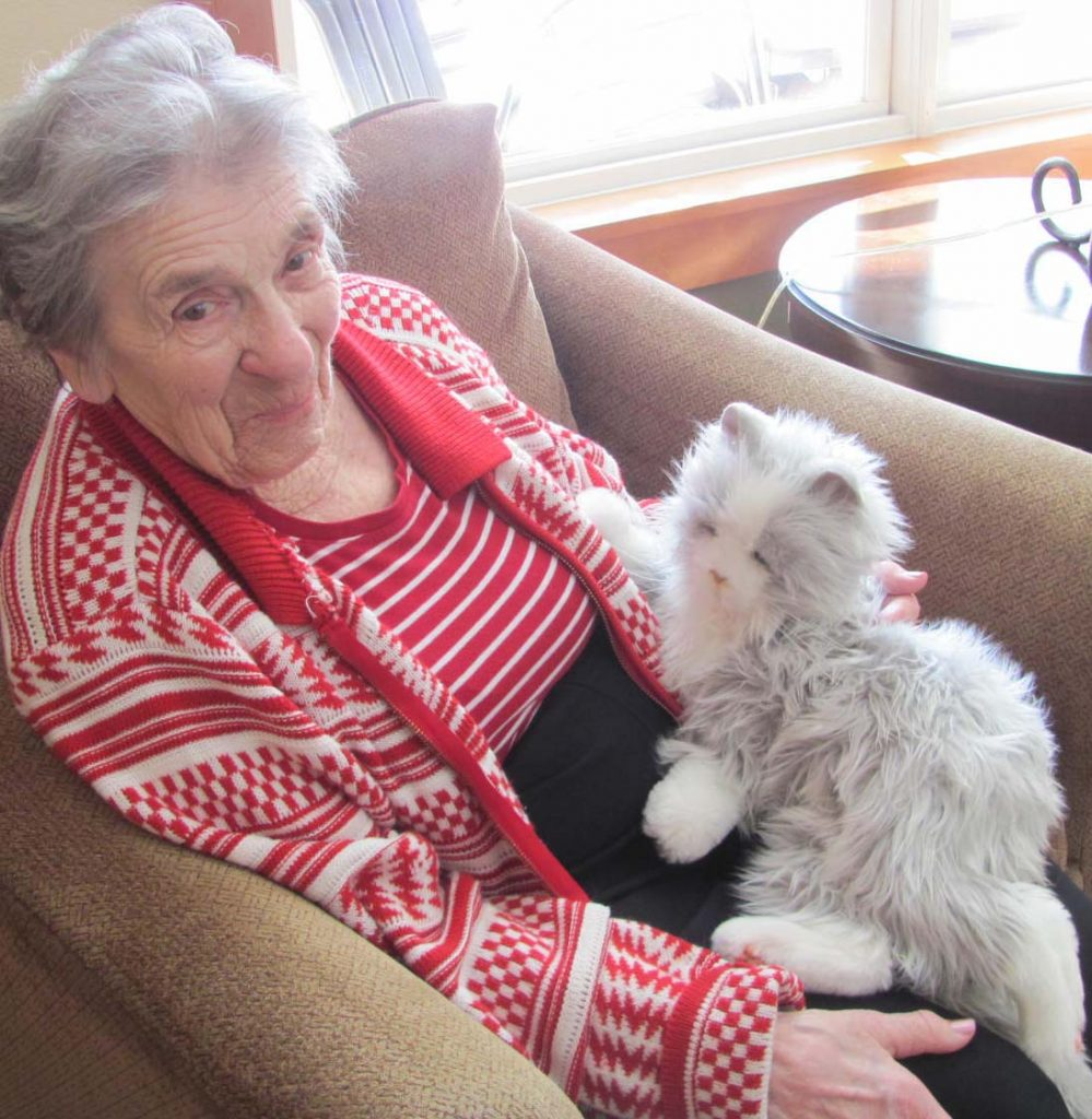 "Agnes Paulsen and one of the Manor's ""cats"" share some together time."