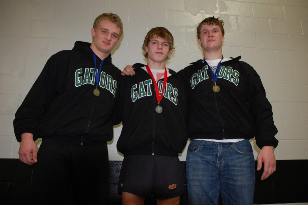 Gators Dominik Vacura, Owen Novacek, and Devin Pries pose for a photo together after each qualifying for the Minnesota State High School League Class A State Wrestling Tournament, March 2-4. (photo by Mel Bergeron)