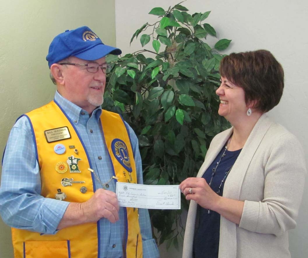 """Greenbush-Badger Lions President Bill Wagner is shown presenting a check in the amount of $500 to Jo Christian, Early Head Start Health manager with Northwest Community Action. The donation is to be applied towards the purchase of a Spot Vision Screener. Christian responded by saying, """"We're extremely proud of the Lions Club for this donation. It's awesome!"""" Not pictured is Krystle Sorenson, Head Start Health manager."""