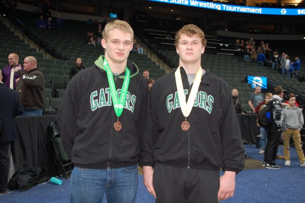 Gators Dominik Vacura and Devin Pries pose together while wearing their state medals after Minnesota high school state tournament wrestling action concluded from the Xcel Energy Center on March 4. Vacura (left), an eighth grader, finished fifth at 195 pounds, and Devin Pries (right), a senior, finished fourth at 285 pounds. (photo by Mel Bergeron)