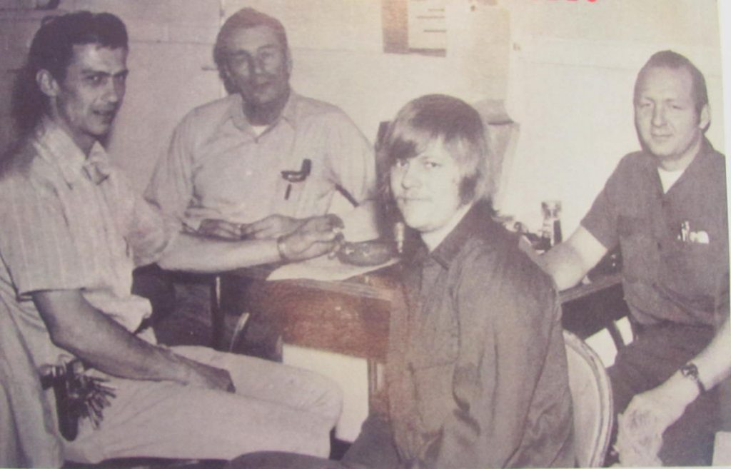 """Dwight Hasson (foreground) is pictured back in the """"early days"""" with his co-workers in the school maintenance department (left to right)-Harvey Dallager, John Stanislawski, and Philip Pelowski."""