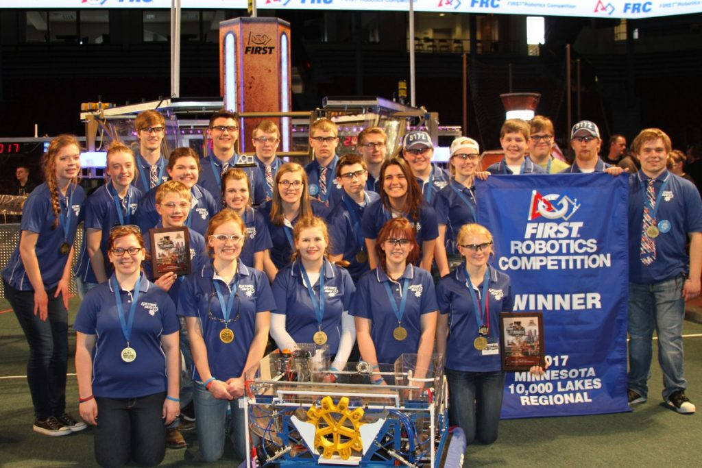 The GMR Robotics team posed with the championship banner and plaque after winning the Minnesota 10,000 Lake Regional, running April 6-8, at the University of Minnesota's Williams Arena in Minneapolis. With this title, the team qualified yet again for the World Championships in St. Louis, April 25-29. (submitted photo)