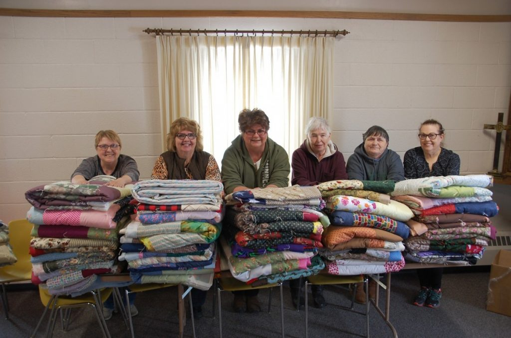Approximately 21women sewed and put together quilts and pillowcase dresses either from home or at the Bethel Lutheran Church from February to April as part of a stewardship for missions program. Some of these women stood behind just some of the 125 quilts they made, including (L-R): Sue Halstensgard, Karen Stephens, Noreen Lorenson, Sharon Taggart, Cathy Kaml, and Trish Brennan. (photos by Ryan Bergeron)