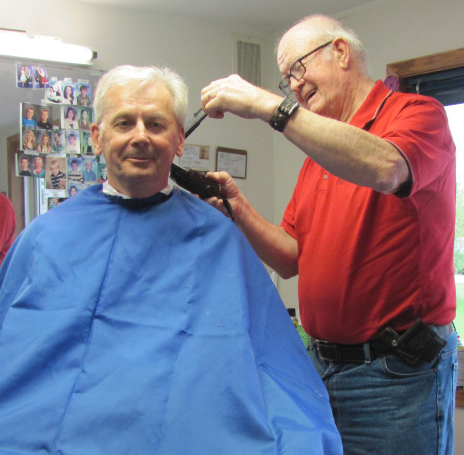 Timmy Kasprowicz returned to Greenbush and received another haircut from local barber Norm Miller. (photo by Mavis Gonshorowski)