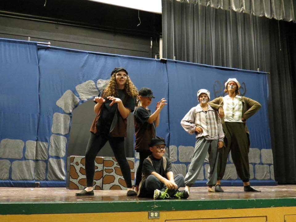 The Vermin (on the left), including Elizabeth Gust as the Badger, Julia Dostal as the Weasel, and Alec Beito (sitting) as the Ferret strike their poses on one side, while the Cat, played by Evie Janousek, and the Fox, played by PFCT Director and Actress Kailah Gordon, strike their own poses on the other side. (photo by Mara Gust)