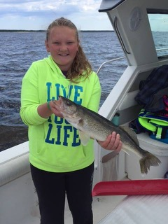 Border View Lodge_girl with pike charter boat
