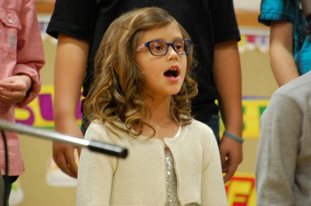 GMR second grade student Savannah Anderson sings during a Christmas concert at the Middle River site last December.