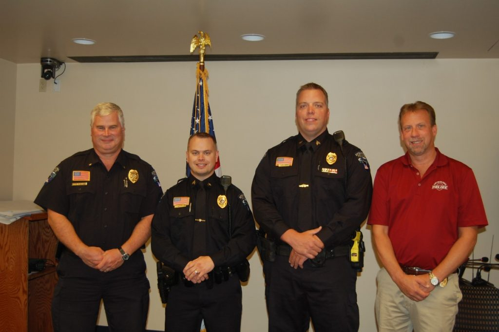 photo by Jaclyn Hicks (left to right) Police Chief Mike Hedlund, Sergeant Jared Quanrud, Sergeant Tony Hart, and Lieutenant Rod Hajicek after the promotion ceremony.