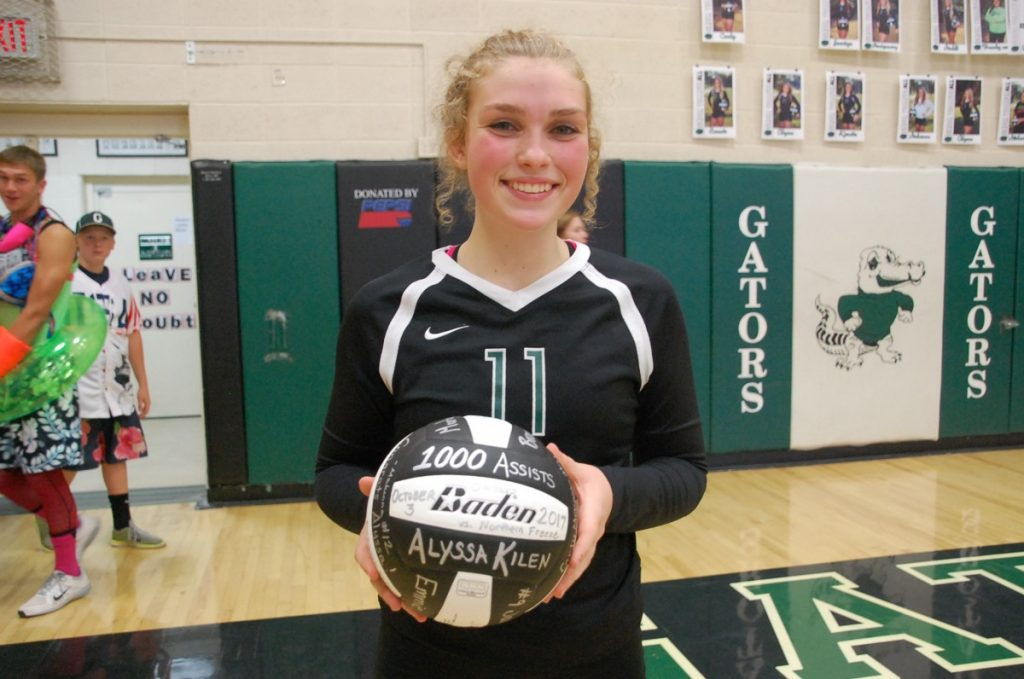 Gator junior volleyball player Alyssa Kilen holds a volleyball commemorating her 1,000 career assist milestone during her team's 3-0 home win over the Freeze on October 3. (photos by Ryan Bergeron)
