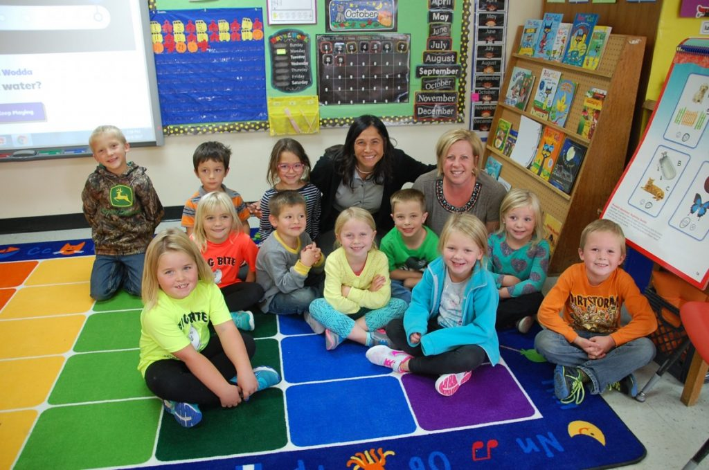 photo by Ryan Bergeron Commissioner Brenda Cassellius poses for a group photo with the GMR (Greenbush site) kindergarten students and their teacher Sheri Jerome after doing the chicken dance with them at the end of the school day. Cassellius visited schools throughout northwest Minnesota, including Roseau, Badger, and Greenbush-Middle River (both sites) on October 9 and Thief River Falls on October 10.