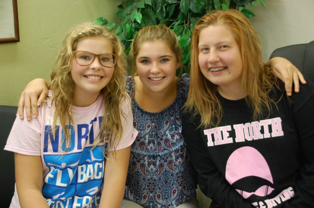 """Gator students Ava Novacek, Greta Novacek, and Cecelia Yeager been working hard this fall--not on a field or on a court, but in a pool. They joined """"The North"""" girls' swim team (a combination of Roseau, Warroad, and Badger/Greenbush-Middle River swimmers) for different reasons and at different times, but they are all glad they did."""
