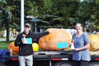 Skip Greenberg and Jan Heitmann next to their 401 pound pumpkin.