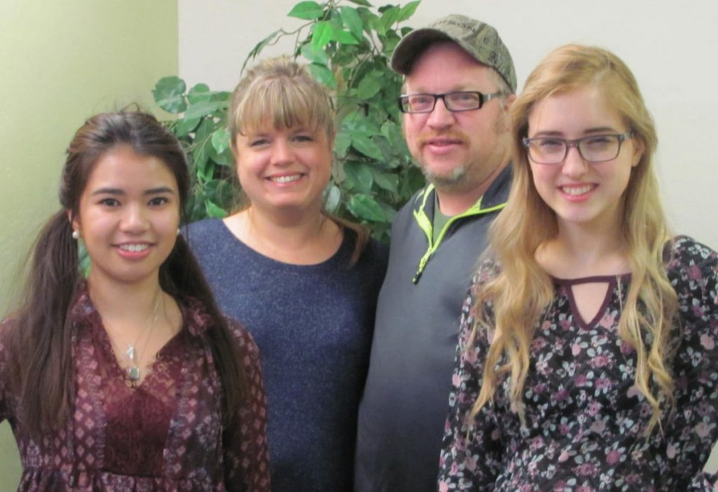 Anh Nguyen (left), foreign exchange student from Germany, is pictured with her host family, Tina, Scott, and Joanna Erickson of rural Badger. (photo by Mavis Gonshorowski)