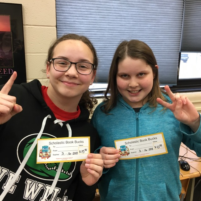 Sisters Elizabeth and Audrey Gust hold up their number one and number two fingers after finishing top two in the GMR Spelling Bee in Greenbush on January 26. (photo submitted by Mara Gust)