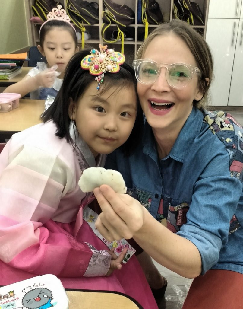 """Farrin Foss and her student are shown with a Korean rice cake dessert called """"songpyeon"""". (submitted photo)"""