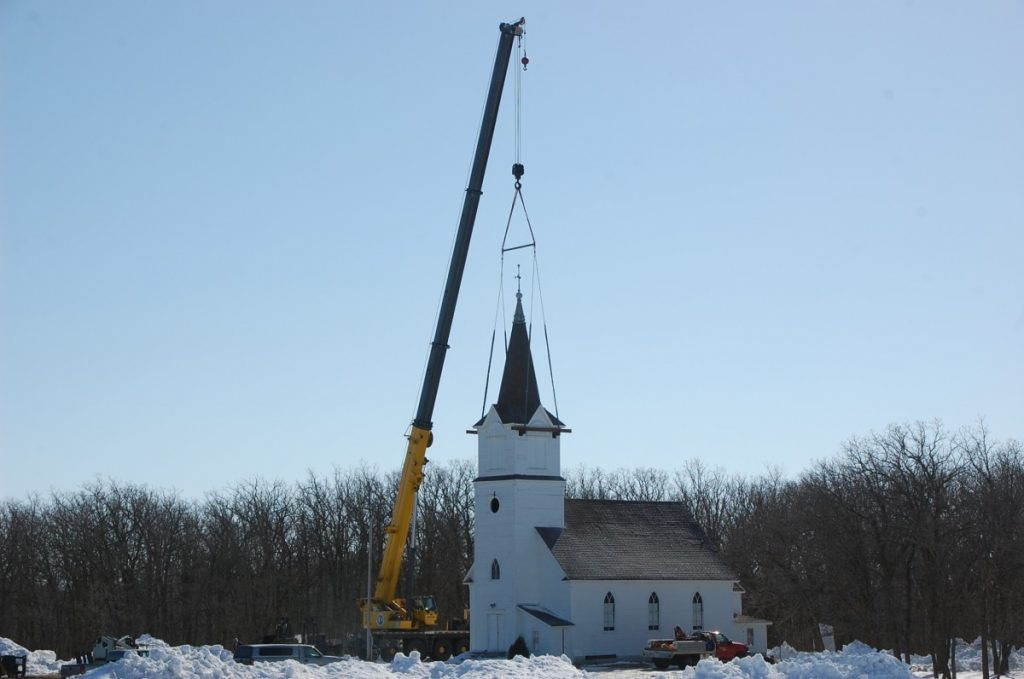 A crew gets in position to lift the steeple off of the Pauli Lutheran Church located at the Pelan Pioneer Park off Highway 11 between Greenbush and Karlstad. Buildings at this park are being moved down the road to Wagon Wheel Ridge, home of the country music, Kick'n Up Kountry, located about a mile west of Karlstad. (photos by Ryan Bergeron)