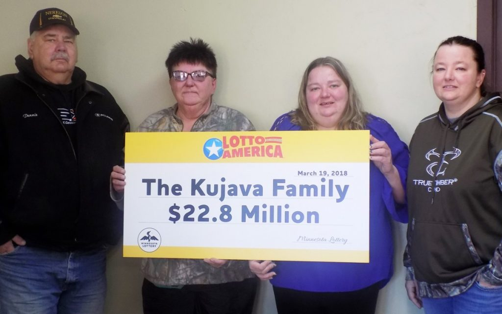 Pictured from left to right is the Kujava family: Dennis, his sister Debbie, the winner of the Lotto America Jackpot, and Dennis' daughters, Denise and Deanna. (photo by Mavis Gonshorowski)
