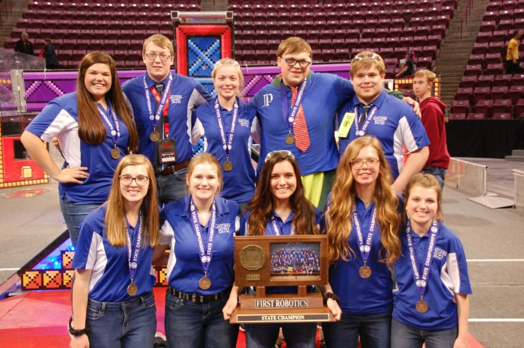 With first place state medals around their necks, GMR Robotics team seniors pose for a group photo with the state champion trophy. They are (L-R): Front: Amy Stauffenecker, Jorden Hendrickson, Kristy Williamson, Jaustyn Dahl, and Emily McLean; Back: Kaiya Novacek, Kyle Stenberg, Emily Tarala, Jonathon Peterson, and Robert Hlucny.