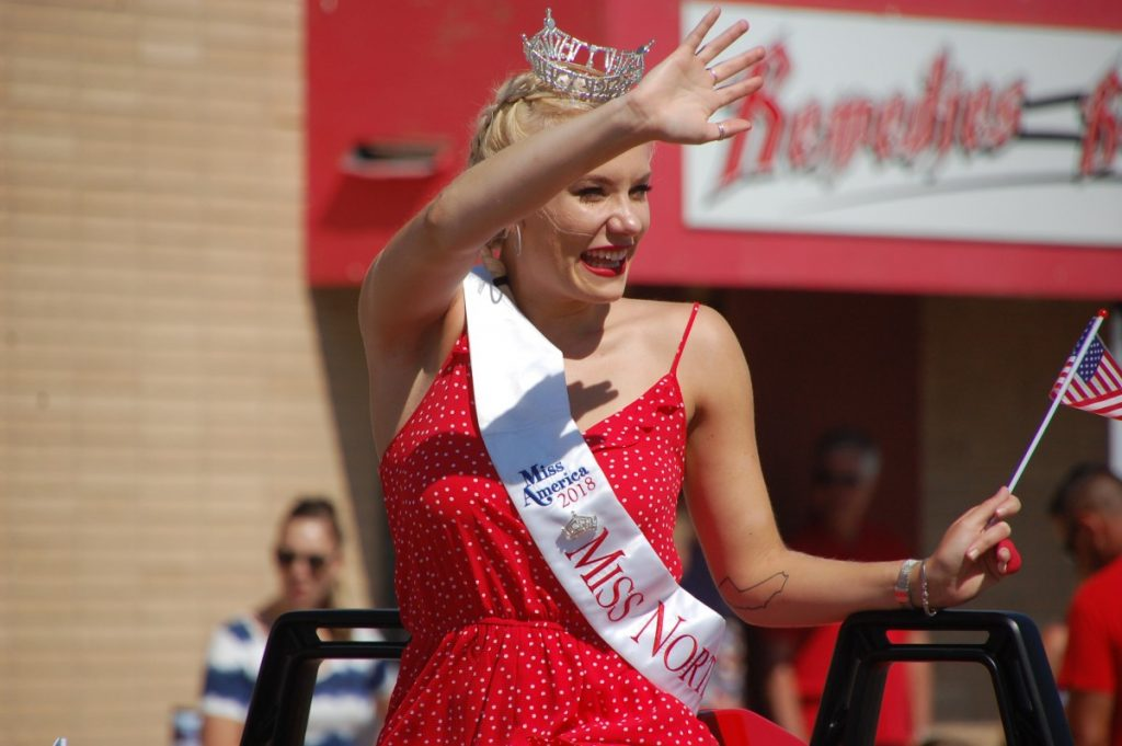 Greenbush native and Miss North Star 2018 Morgan Berg waves to the crowd at this year's Greenbush Fourth of July parade. Thanks to claiming the Miss North Star title, Berg qualified for this year's Miss Minnesota pageant, her second consecutive year advancing to this pageant. She finished in the top 11 and claimed the Miss Congeniality award at this year's pageant. (photo by Ryan Bergeron)