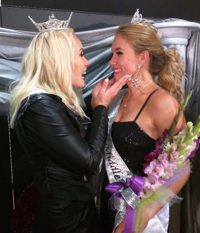 Miss Middle River 2014 Morgan Berg (left), expresses her excitement when congratulating her sister, Aubre Berg, the newly-crowned 2018 Miss Middle River at the pageant held the evening of September 22, 2018.