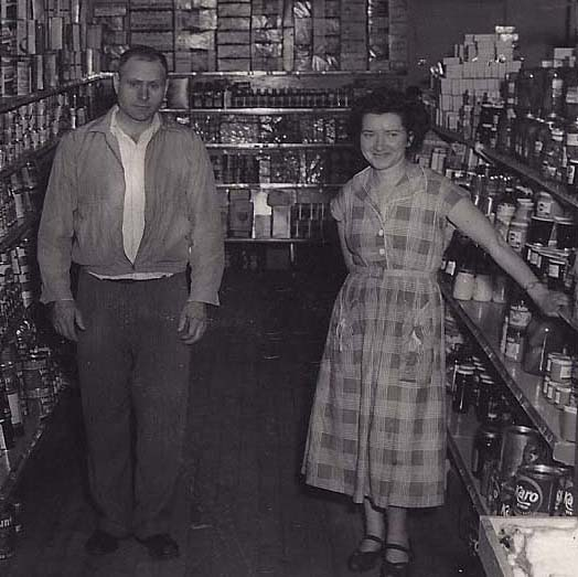 Mike and Frances Korczak are pictured in their grocery store, Mike's Red Owl, in the 1950's.