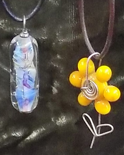 Two of a huge selection of glass Pyro Beads made by Nancy Peterson.