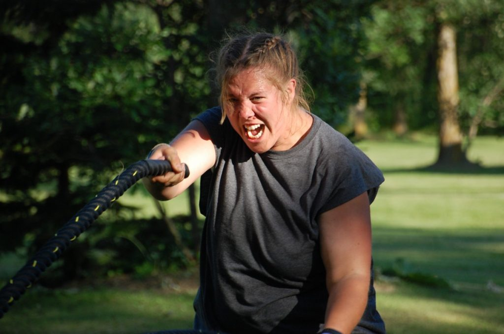 Shaylyn Hastings from Kerkhoven, Minn., gives it her all during a rope workout at the third annual 24-hour straight Tata's Gym Jam Boot Camp, July 13 and 14, at the Wiskow-Nichols home in rural Greenbush. Hastings returned for a third time due to the personal growth that has come from participating in this camp, beyond just physical. (photo by Ryan Bergeron)