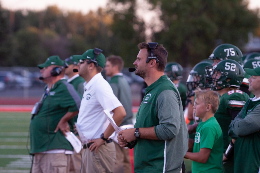 photo by Bruce Brierley Gereen Wave Head Coach Ryan Kasowski concentrates on th eexecution of a playb during last year's season. Kasowski  empowers his players to make decisions and work towards their common goal of success both on and off the field.