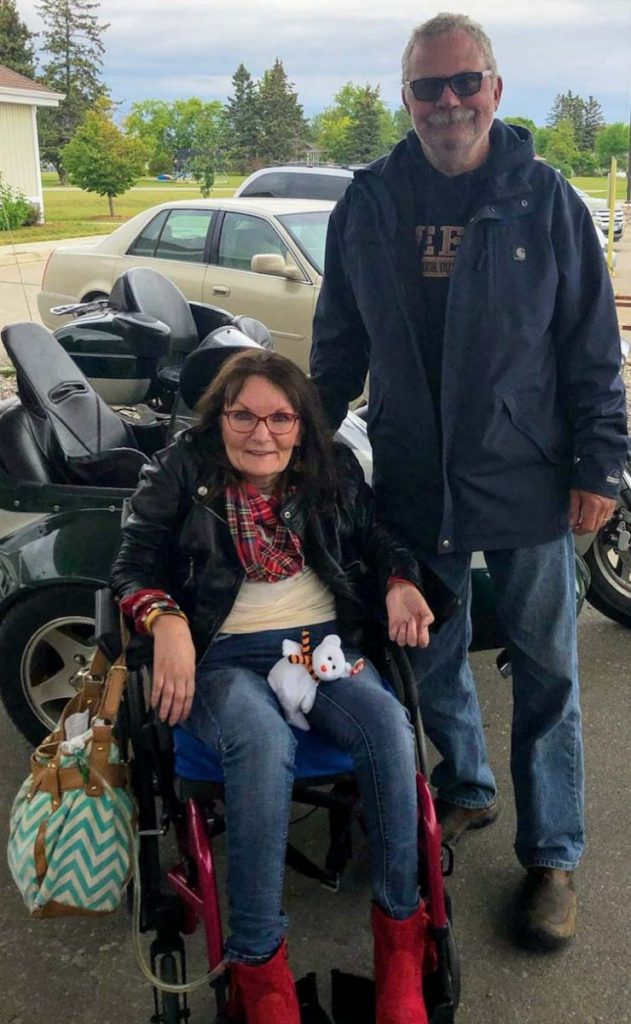 "Cindy Hagen is pictured with Sid Skogstad who made it possible for Cindy to fulfill another wish on her bucket list when she rode in the sidecar of Sid's motorcycle on the fourth annual ""Cindy's Ride"" from Halma to Karlstad, Minn. (submitted photo)"