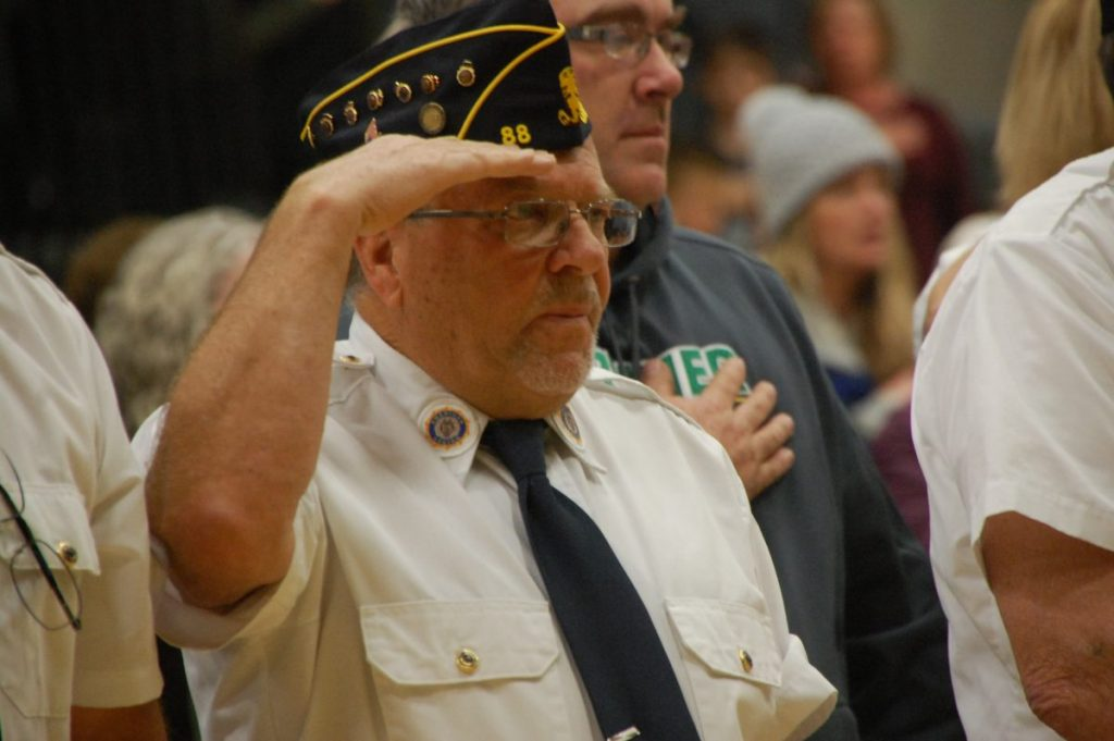 Area veteran and Greenbush American Legion member John Stauffenecker stood at attention and saluted during the playing of the National Anthem by the GMR Concert Band at the November 12, 2018 Veterans Day program in Greenbush. (photo by Ryan Bergeron)