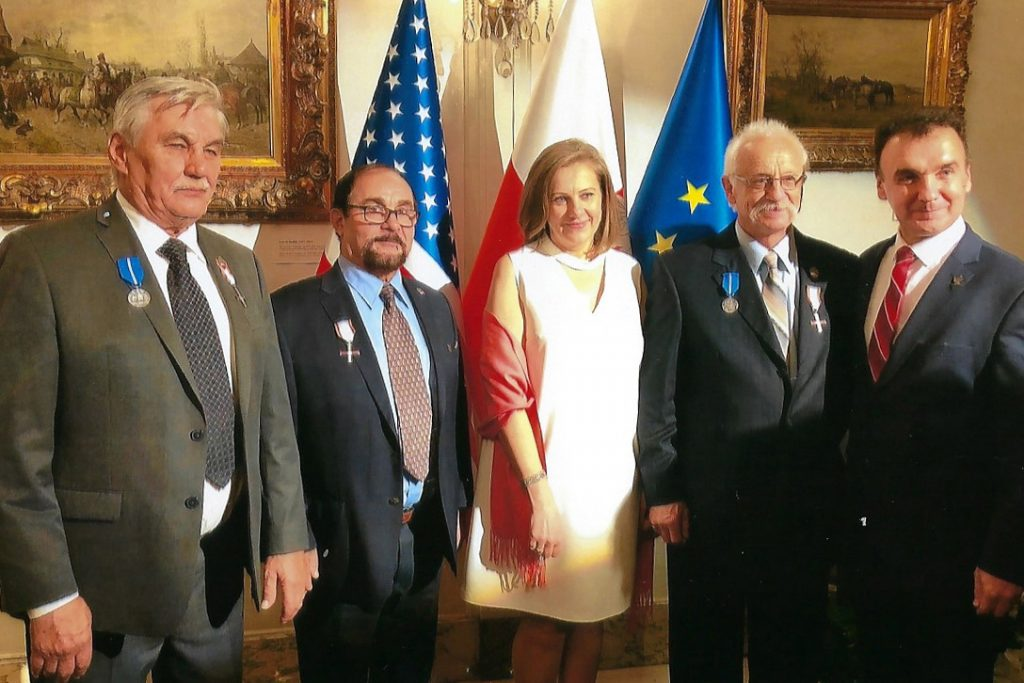 Andrzei Rymsza, second from the left, is pictured after receiving The Cross of Freedom and Solidarity at the Republic of Polish Counsulate in Chicago, Ill., on November 7, 2019.  Making the presentation is Consul General Mr. Piotr Janicki, far right.  The Consul General's wife is shown in the center.  The other two gentlemen, former residents of Poland and now living in the United States, were also recipients of the Cross of Freedom and Solidarity medals at the time.