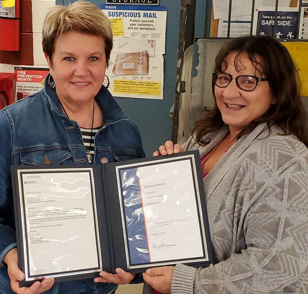 Kari Wiskow (left) is shown with her Certificates of Apprecation from the U.S. Postal Department.   Making the presentation is Greenbush Postmaster Nancy Kaml. (submitted photo)