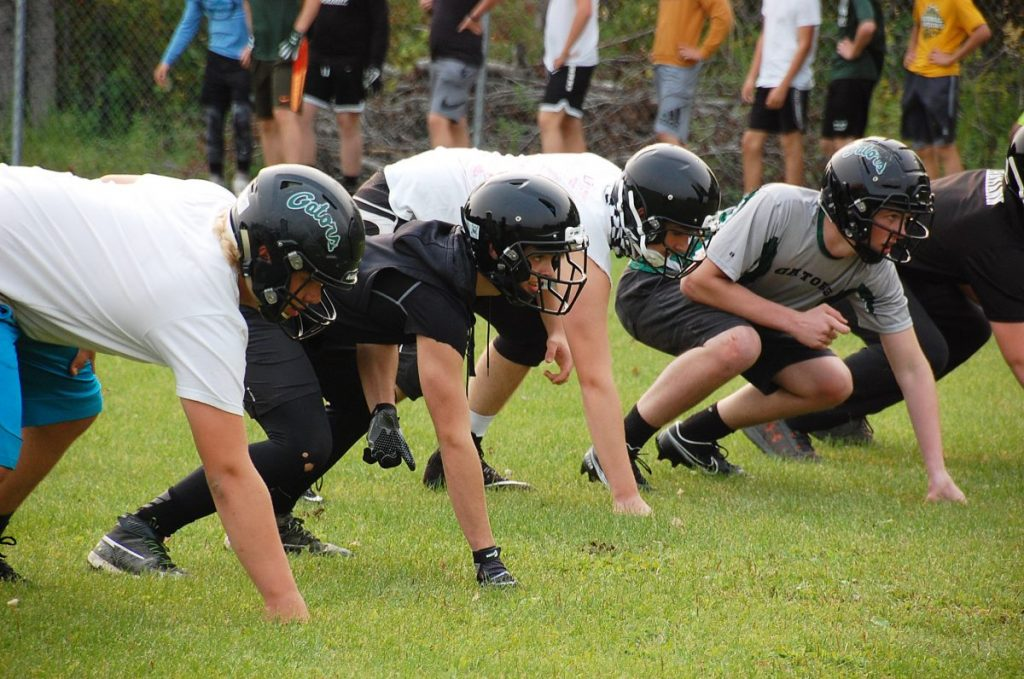 Some Gator Football players line up in their three-point stances during a practice session drill at the practice fields behind the Greenbush-Middle River School in Greenbush back on September 14. The team opens its regular season on the road in Fertile versus the Fertile-Beltrami Falcons on October 9. (photo by Ryan Bergeron)