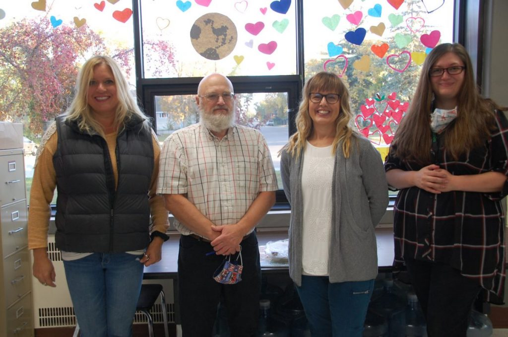 New teachers to the 2020-21 Greenbush-Middle River School staff pose for a photo in the school's teacher's lounge, including (L-R): Mindy Helle, John Moore, Robin Waage, and Karis Musker. Waage has worked for the GMR School in the past. (photo by Ryan Bergeron)