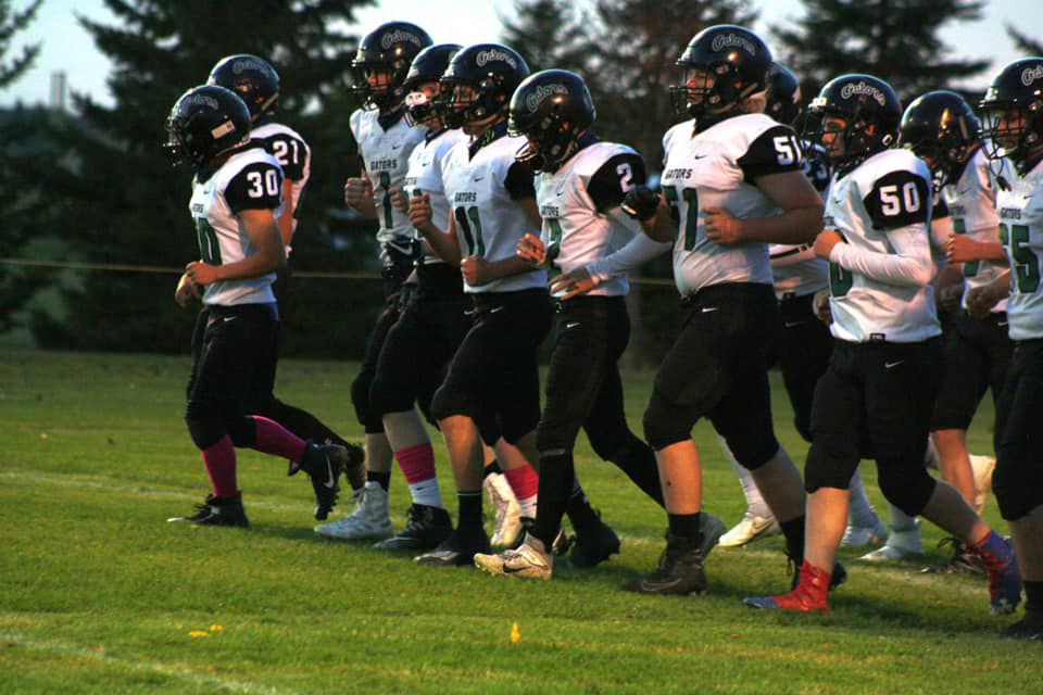 The Gator Football team enters the field as one prior to its season opening game versus the Fertile-Beltrami Falcons in Fertile on October 9— a game the Gators lost by a 28-6 final.