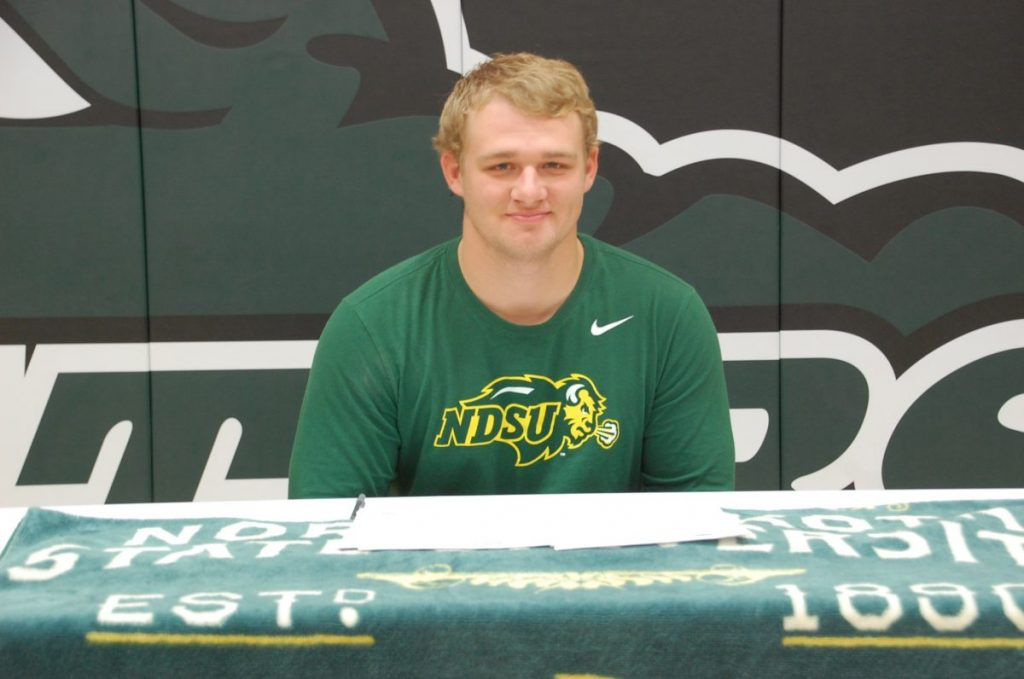 Gator senior wrestler Dominik Vacura smiles for a photo after officially signing his letter of intent to wrestle for the North Dakota State University Bison starting next year. Vacura has over 100 career pins and is currently sixth in all-time individual program wins, at 179— 26 wins from breaking the record for most wins in program history. (photo by Ryan Bergeron)