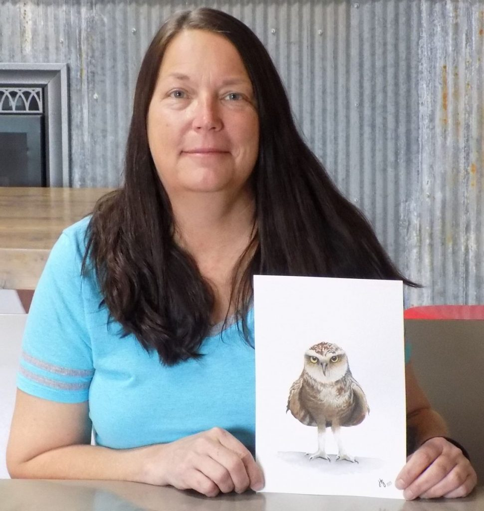Heidi Sather is pictured with her version of a cartoon owl. She gifted her latest grandchild with a replica painting including a wooden frame she made to go with it. (photo by Mavis Gonshorowski)