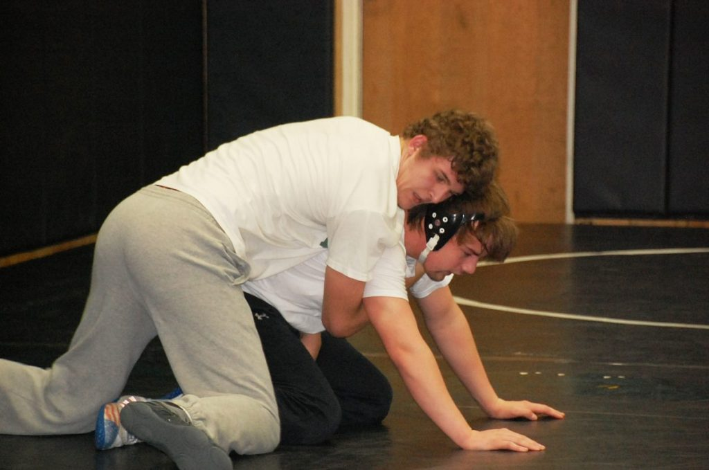 Caleb Vacura works to break down Gator teammate Ethan Waage during some live wrestling at a morning practice on January 8— concluding the first week of practice. (photo by Ryan Bergeron)