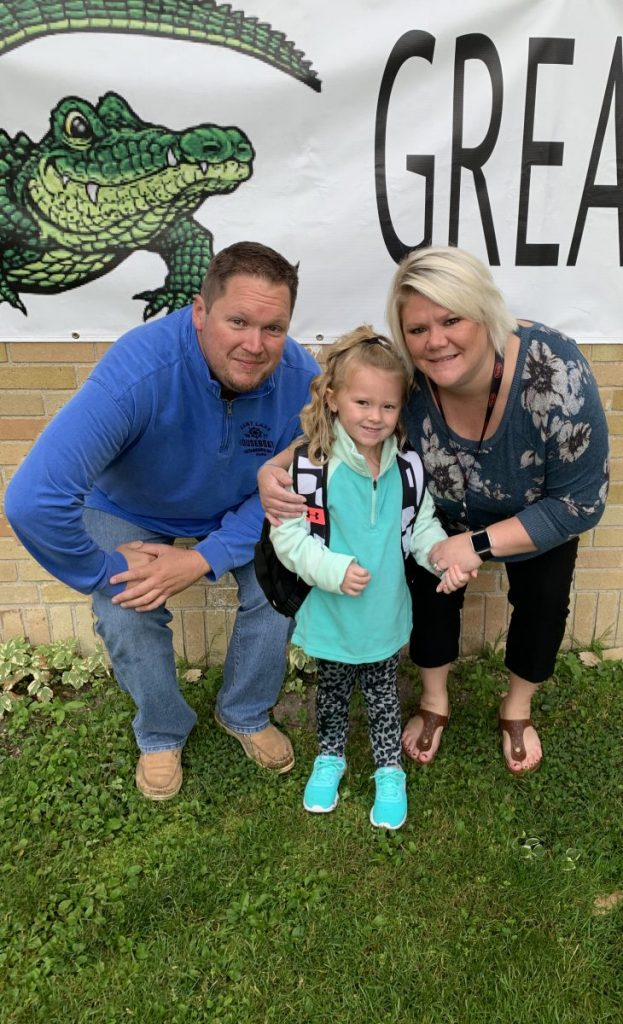 "Eric Etherington, his preschool-aged daughter Kamber, and his wife Nicole pose for a photo together. Beginning his employment at Central Boiler right after Memorial Day in 2011, Etherington and his now wife of six and half years, Nicole, decided to stay in Greenbush, as Etherington considered it ""a nice, safe place to start a family."" (submitted photo)"